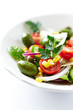 Mediterranean-style salad with whole green olives (close up)
