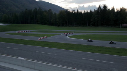 VRANSKO, SLOVENIA - SEP 2013: Go-kart drivers compete for first place. Go-cart and cars simulations event.