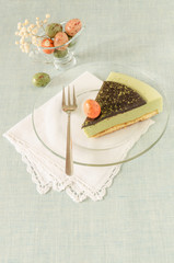 Piece of easter cake with tea matcha on glass plate