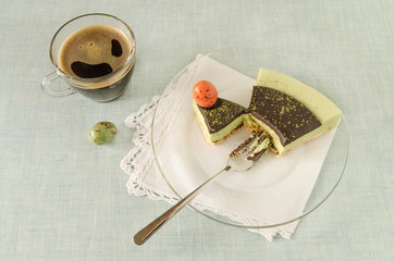 Piece of easter cake with matcha tea