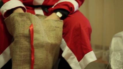 Santa Claus hands holding a bag, close up