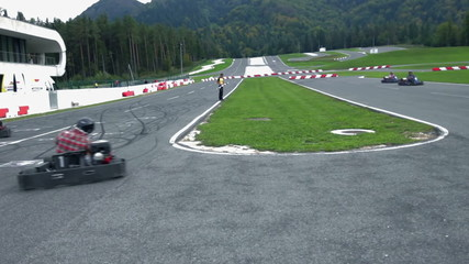 VRANSKO, SLOVENIA - SEP 2013: Go-cart racers drive through edgy turn. Go-cart and cars simulations event.