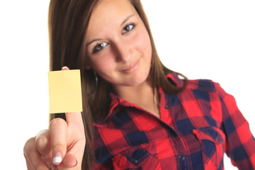 Beautiful woman showing a blank yellow paper note isolated on a