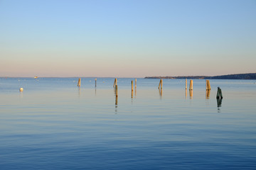 Dock pilings on Penobscot Bay inside the Rockland Breakwater and