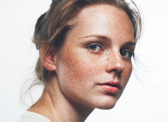 Woman studio portrait with freckles  young beautiful