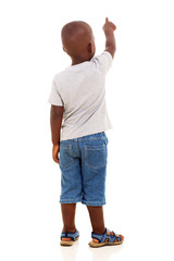 back view of little african boy pointing