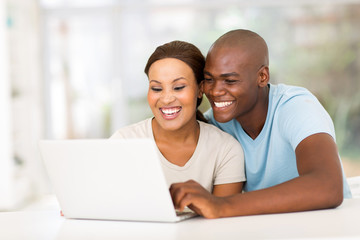 young african couple using laptop computer