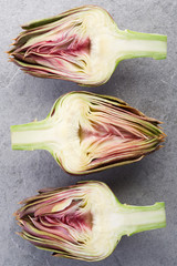 Artichokes section on gray stone background
