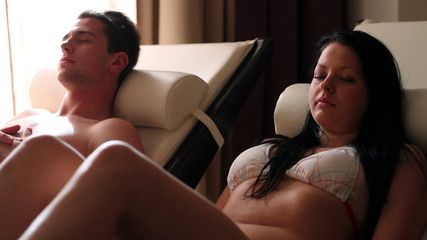 Shot of a couple relaxing and sleeping in spa