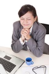 Praying business woman