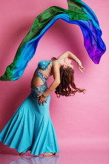 Beautiful belly dancer is wearing a blue costume