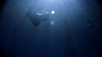underwater activity and big shoe sinking under water
