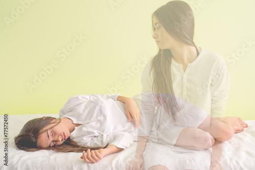 Young girl is waking up again. When the soul leaves the body - 77572450