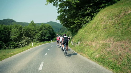 Following group of bicycle competitors