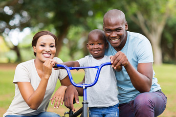 afro american family having fun together outdoors