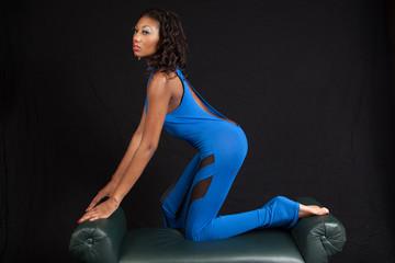 Black woman kneeling on a bench
