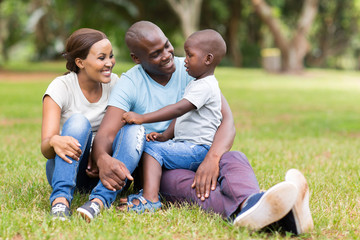young african family sitting outdoors