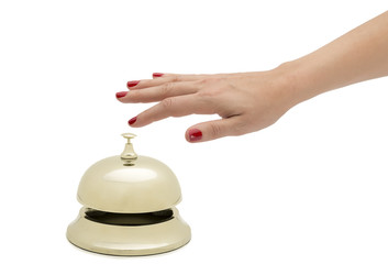 Hand of a woman ringing hotel bell isolated on white.