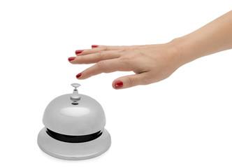 Female Hand Ringing Hotel Bell