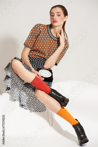 Fashion model pose on light background - 77576232