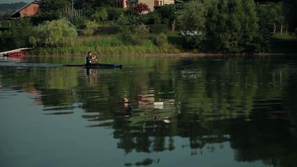 Kayaker in countryside kayaking in lake