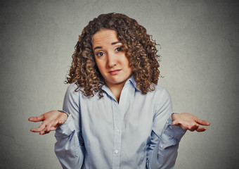 woman arms out shrugs shoulders in doubt i don't know