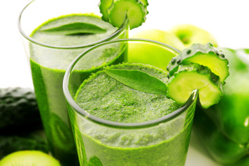 Green fresh healthy juice with vegetables on white background