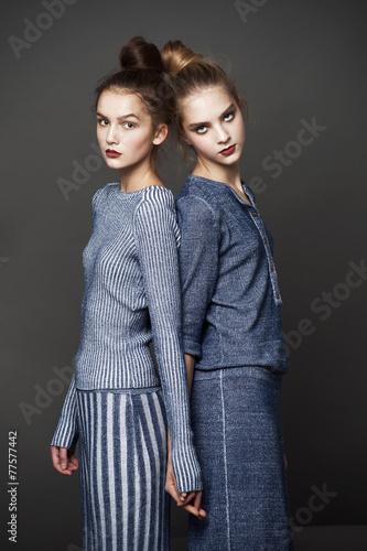 Fashion model pose on light background - 77577442
