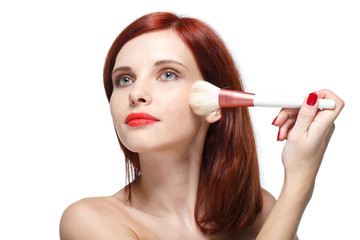 Woman with brush for make-up.