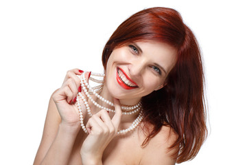 Portrait of beautiful red- haired woman.