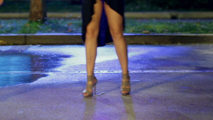 Women with long legs in high heels and miniskirts are dancing