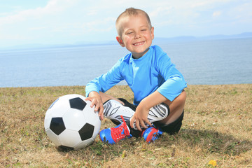 the boy with soccer ball
