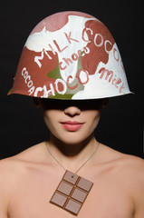 Beautiful woman with chocolate helmet and badge