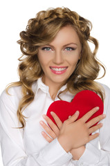 Young woman pushes heart to himself