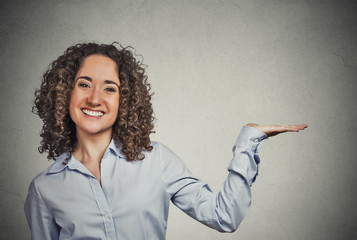 woman gesturing, presenting copy space grey background