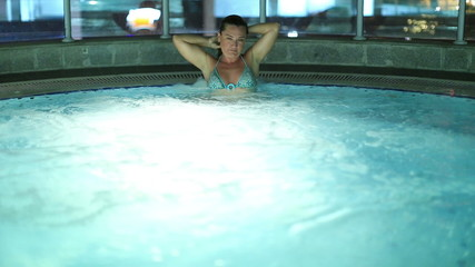 attractive blonde women in luxury hot tub at night