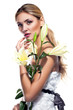 Blond woman with fresh clean skin and white lily flower isolated