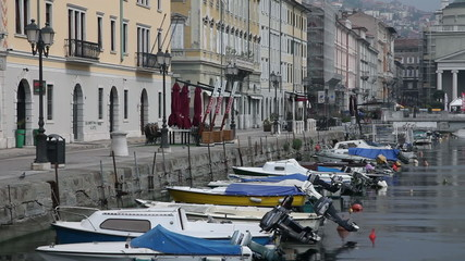 Shot of the sea canal in Trieste, parked with boats