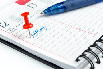 meeting appointment written on a weekly agenda