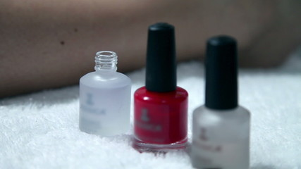 Close up of a nail polish in a beauty spa while using it