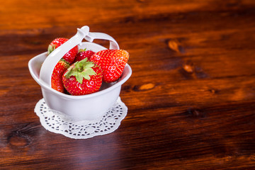 strawberries in bowl on wood table