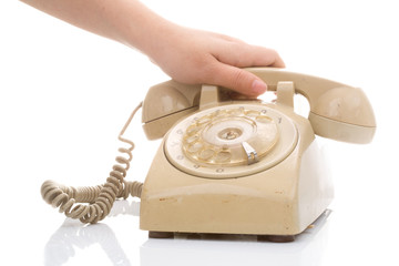 Hand hold vintage telephone cream color