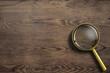 Leinwanddruck Bild - magnifying glass or loupe on wooden table