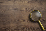 magnifying glass or loupe on wooden table