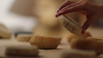 HD1080p: Close up of woman's hand putting small cheeses together