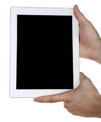Hands holding tablet PC isolated on white