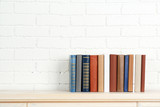 Fototapety Books on shelf on wall background