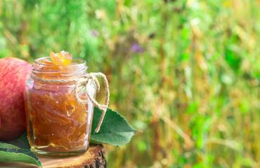 Jar of apple jam at left side