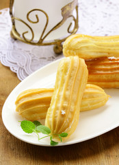 choux pastry dough eclairs with vanilla cream