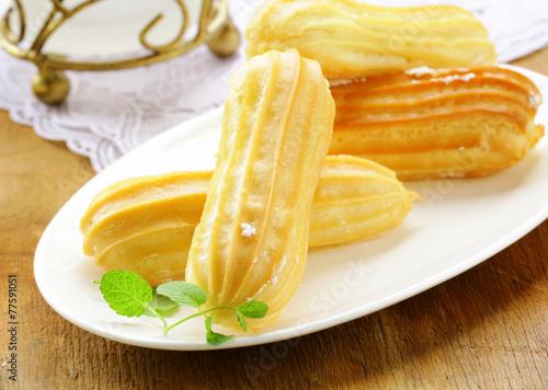 Fototapeta choux pastry dough eclairs with vanilla cream